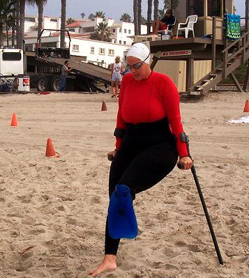 Below knee amputee walking with shinfin™ fin for open water ocean swim.
