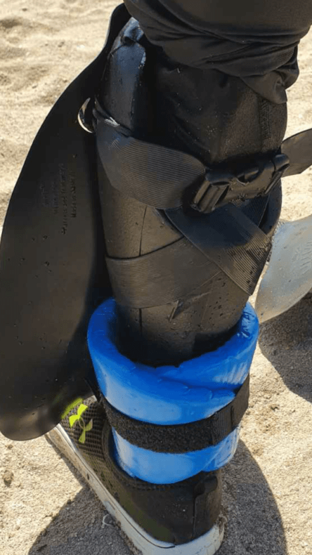 shinfin™ fin on above knee amputee prosthetic leg with ankle float for snorkeling: rear view