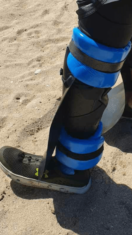 shinfin™ fin on above knee amputee prosthetic leg with leg & ankle floats for snorkeling: side view