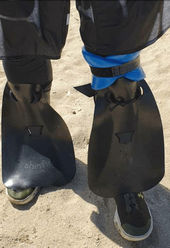 shinfin™ fin on above knee amputee prosthetic leg with leg float for snorkeling: front view