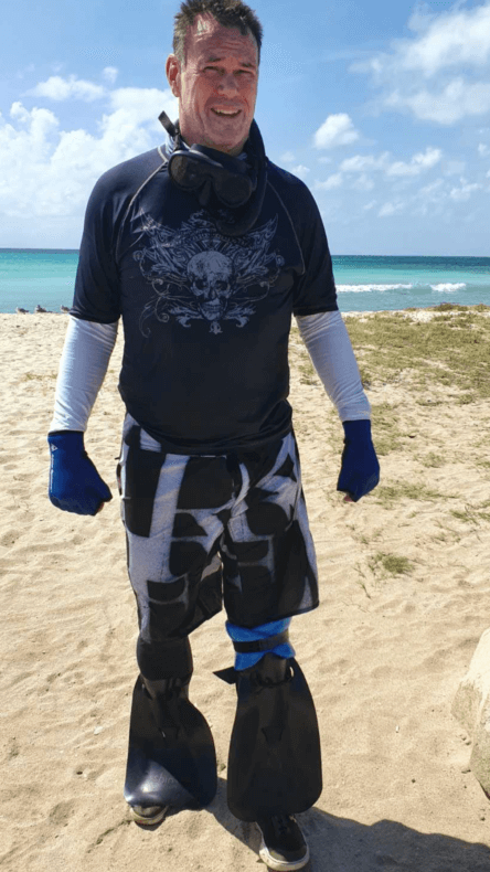 shinfin™ fin on above knee amputee prosthetic leg with leg float for snorkeling