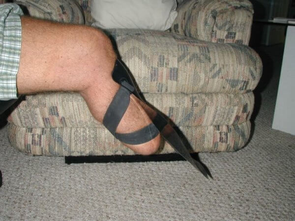 Transtibial amputee, bent knee with shinfin™ fin, side view.